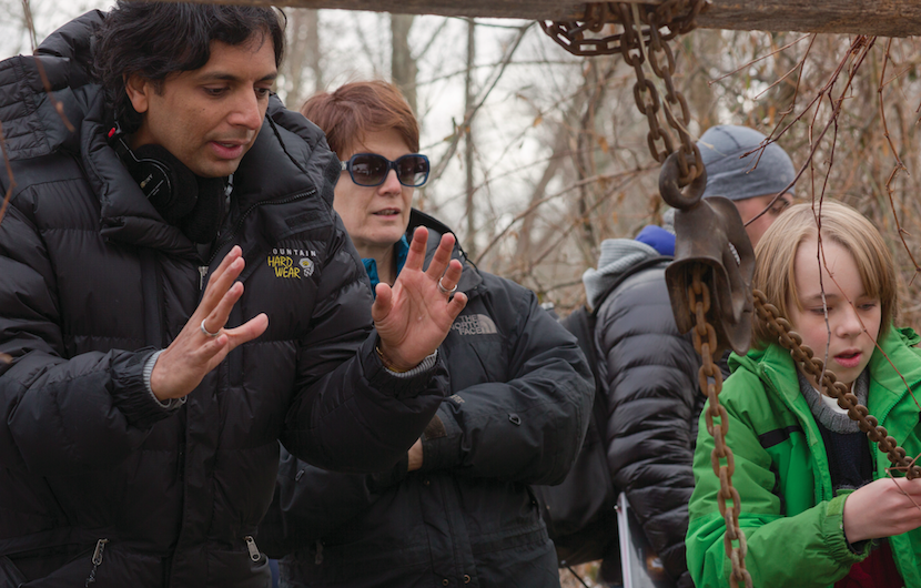"(L to R) Writer/Director/Producer M. NIGHT SHYAMALAN, cinematographer MARYSE ALBERTI and ED OXENBOULD as Tyler on the set of ""The Visit"". Photo by John Baer. Courtesy Universal Pictures."