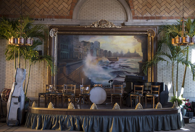 Custom built palm trees, a stage, a huge painting and more to evoke early 20th century Cuba. Courtesy HBO.