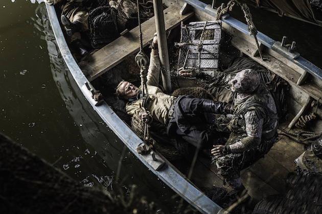 Jorah Mormont (Ian Glen) fights off a Stone Man. Photo by Helen Sloane. Courtesy HBO.
