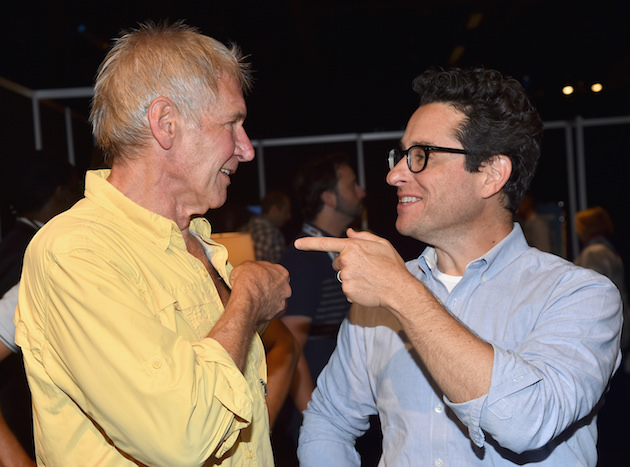 "ANAHEIM, CA - AUGUST 15:  Actor Harrison Ford (L) and director J.J. Abrams of STAR WARS: THE FORCE AWAKENS took part today in ""Worlds, Galaxies, and Universes: Live Action at The Walt Disney Studios"" presentation at Disney's D23 EXPO 2015 in Anaheim, Calif.  (Photo by Alberto E. Rodriguez/Getty Images for Disney) *** Local Caption *** Harrison Ford; J.J. Abrams"