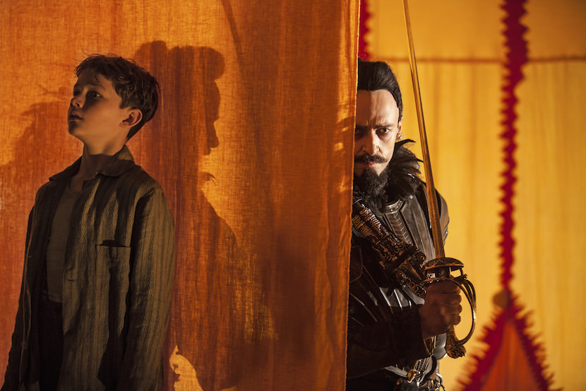 """(L-r) LEVI MILLER as Peter and HUGH JACKMAN as Blackbeard in Warner Bros. Pictures and RatPac-Dune Entertainment's action adventure """"PAN,"""" a Warner Bros. Pictures release."""