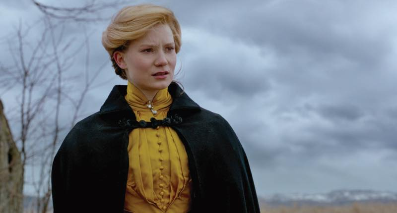 Mia Wasikowska as Edith Cushing in burnt orange. Courtesy Universal Pictures/Lionsgate.