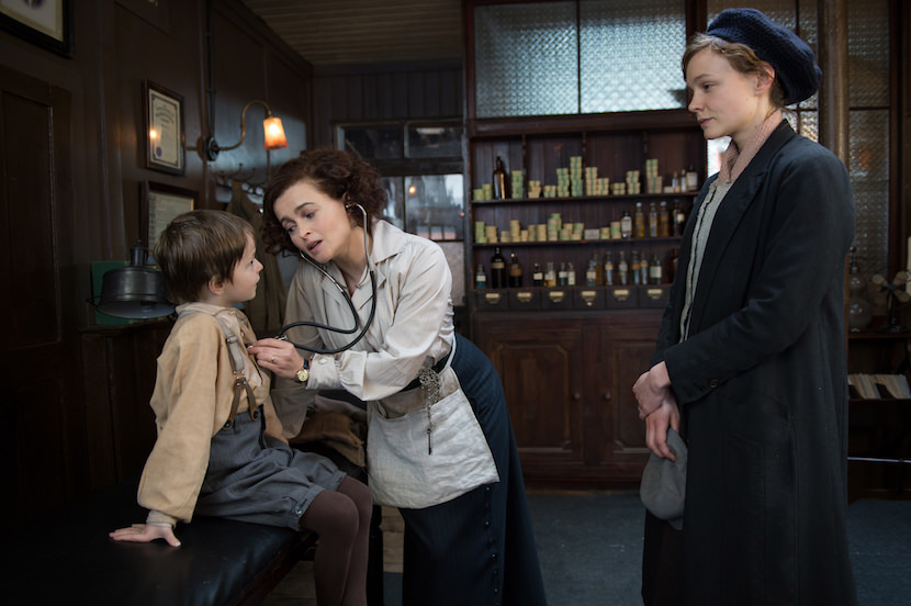 (L to R) Adam Michael Dodd as George Watts, Helene Bonham Carter as Edith Ellyn and Carey Mulligan as Maud Watts in director Sarah Gavron's SUFFRAGETTE, a Focus Features release.   Credit : Steffan Hill / Focus Features