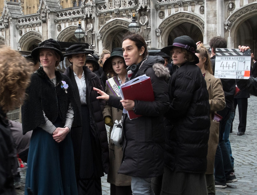(L to R) Actress Anne-Marie Duff, actress Carey Mulligan, actress Helena Bonham Carter, director Sarah Gavron, and actress Romola Garai on the set of SUFFRAGETTE, a Focus Features release.  Credit : Steffan Hill / Focus Features