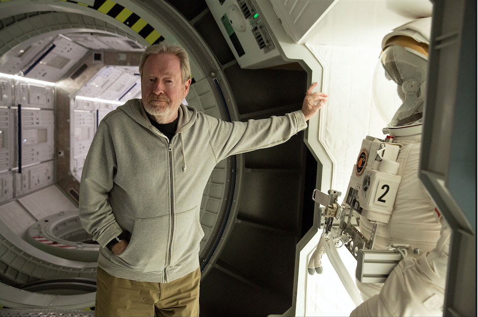 Ridley Scott poses on the set of the spaceship Hermes. The stunt and FX crew created an elaborate winch system to re-create zero gravity. Photo by Giles Keyte. Courtesy 20th Century Fox