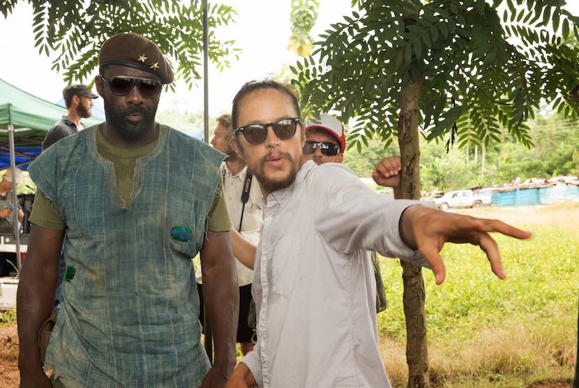 "Idris Elba and Cary Fukunaga in the Netflix original film ""Beasts of No Nation"" Photo Courtesy Netflix"