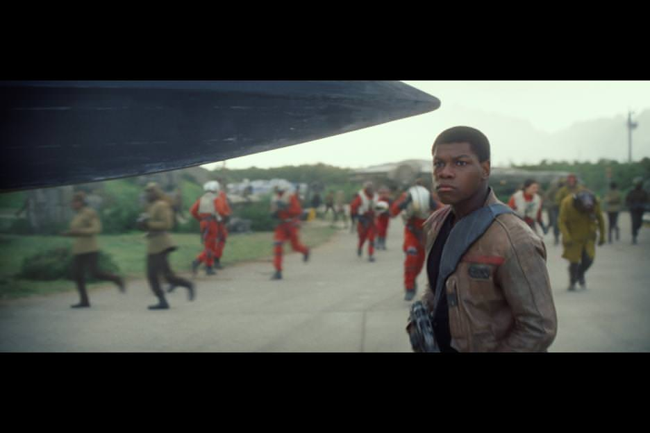 Finn (John Boyega) the moment he bumps into Poe Dameron (Oscar Isaac) on the tarmac. Courtesy Walt Disney Pictures/Lucasfilm