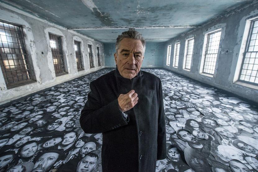 Ellis - Robert De Niro among thousands of portraits, on set.jpg
