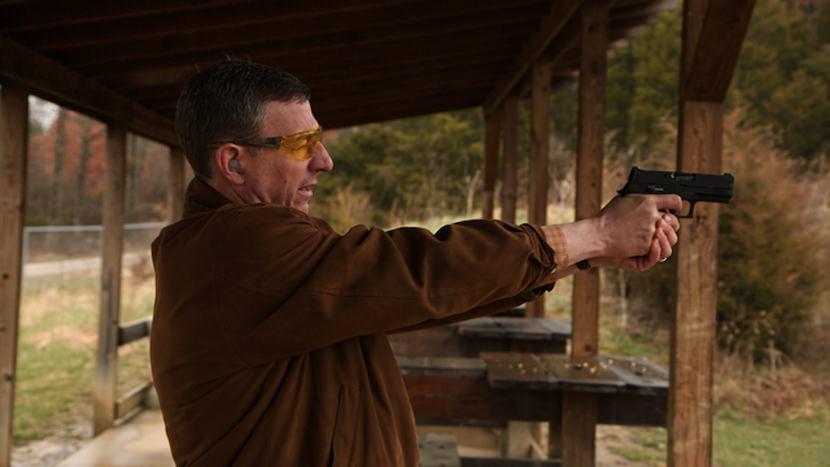 Rev. Bob Scheck at the firing range. Photo by Jeff Hutchens.