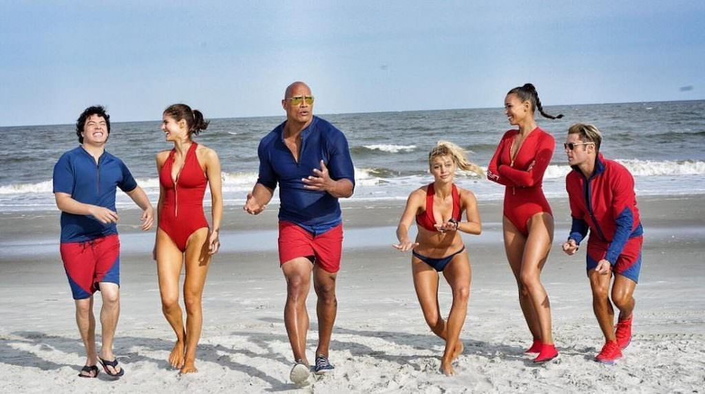 dwayne-johnson,-alexandra-daddario,-zac-efron,-ilfenesh-hadera,-jon-bass,-and-kelly-rohrbach-in-baywatch-(2017).jpg