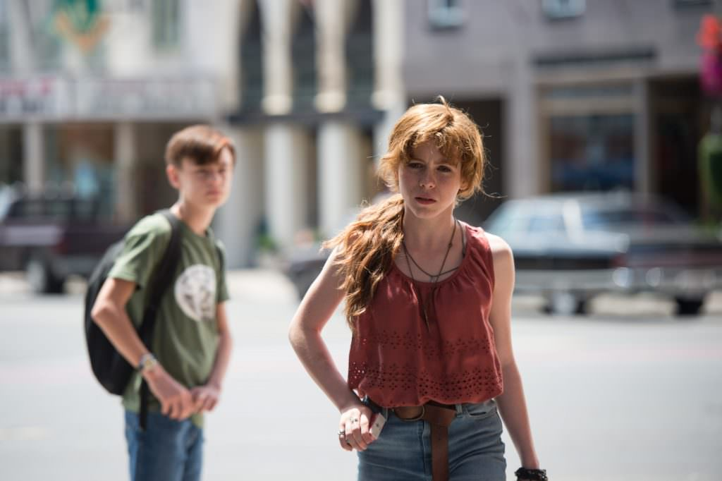 Jaeden Liberher and Sophia Lillis in It. Courtesy: Warner Bros. Pictures