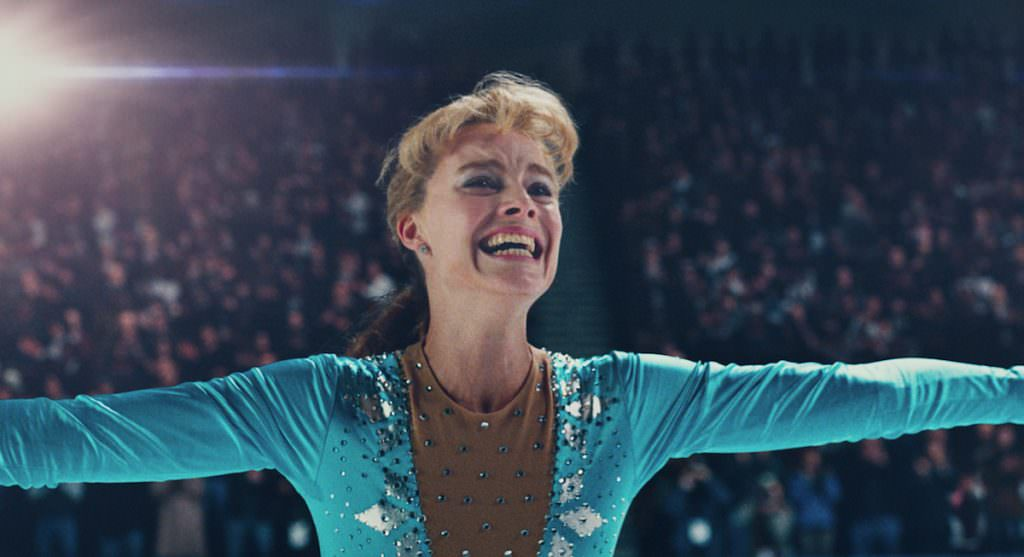 1- Tonya Harding (Margot Robbie) after landing the triple axel in I, TONYA, courtesy of NEON