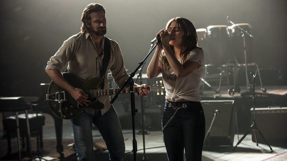 "(L-R) BRADLEY COOPER as Jackson Maine and LADY GAGA as Ally in the drama ""A STAR IS BORN,"" from Warner Bros. Pictures, in association with Live Nation Productions and Metro-Goldwyn-Mayer Pictures, a Warner Bros. Pictures release. Photo Credit: Neal Preston"