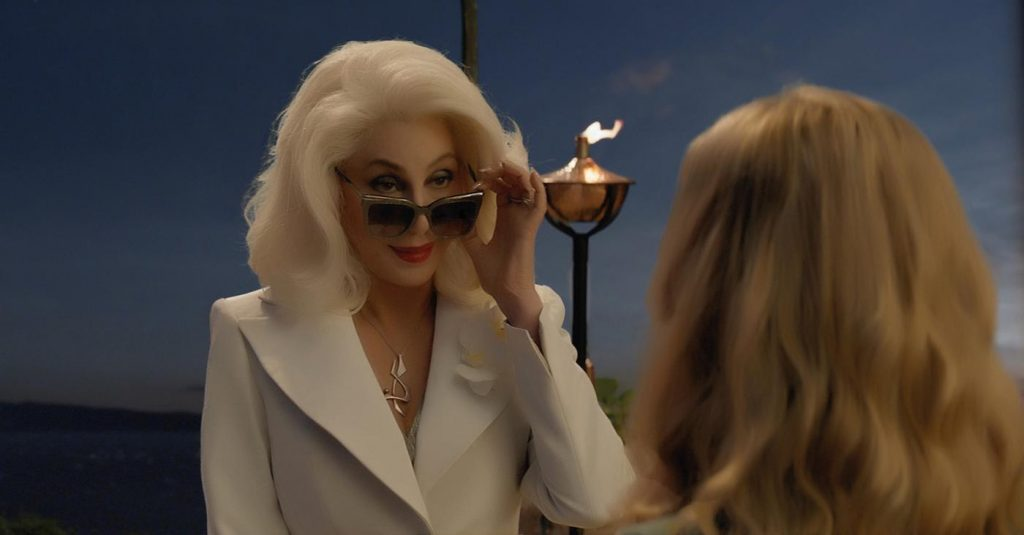 "Ruby (CHER) surprises granddaughter Sophie (AMANDA SEYFRIED) in ""Mamma Mia! Here We Go Again."" Photo Credit: Universal Pictures"