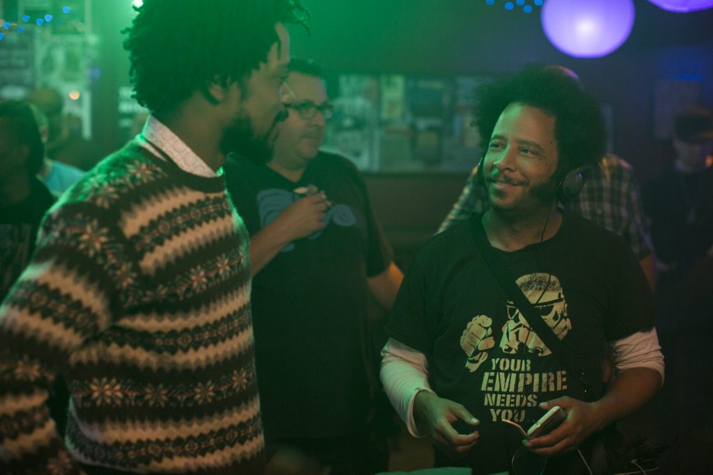 (l to r.) Lakeith Stanfield and director Boots Riley on the set of SORRY TO BOTHER YOU, an Annapurna Pictures release. Credit: Peter Prato / Annapurna Pictures