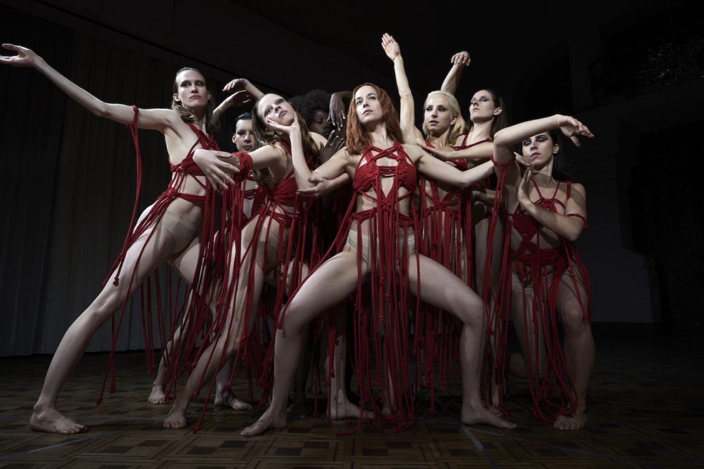 Mia Goth as Sara and Dakota Johnson as Susie star in Suspiria. Photo Credit: Alessio Bolzoni; Courtesy of Amazon Studios