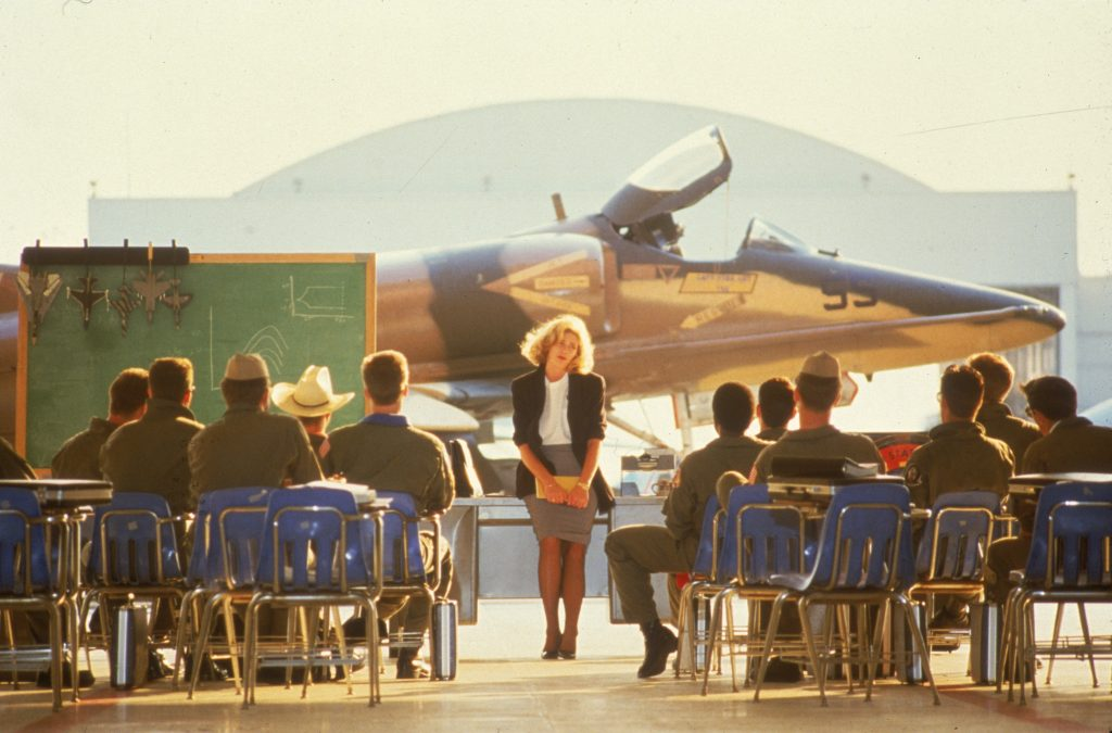 Kelly McGillis briefing the Navy pilots in the original 'Top Gun.' Courtesy Paramount Pictures.