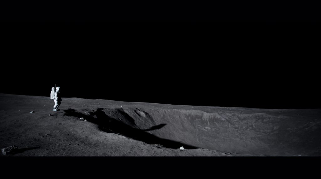 Final composite of Neil standing in front of crater on the moon. Neil throws daughters bracelet into the crater. We deepened the crater to give illusion of black hole as well as set clean up. Light fall off was extended to mimc the sunlight on moon in addition to set extensions.
