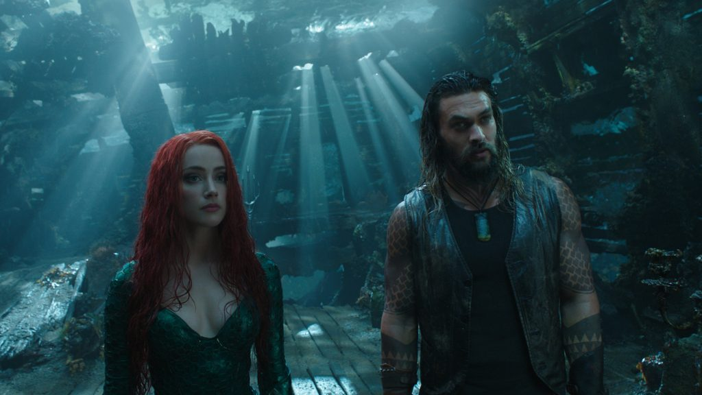 "Caption: (L-r) AMBER HEARD as Mera and JASON MOMOA as Aquaman in Warner Bros. Pictures' action adventure ""AQUAMAN,"" a Warner Bros. Pictures release."
