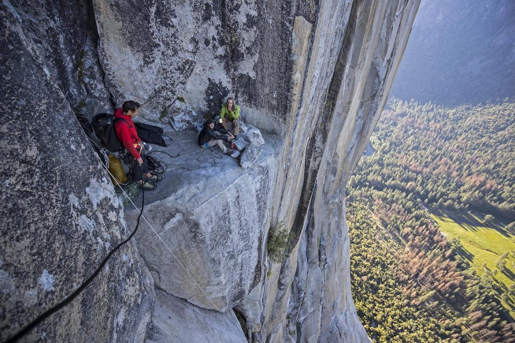 Alex Honnold meeting a couple climbers as he rappels El Capitan's Freerider route to practice on the climb before his free solo attempt. National Geographic/Jimmy Chin.