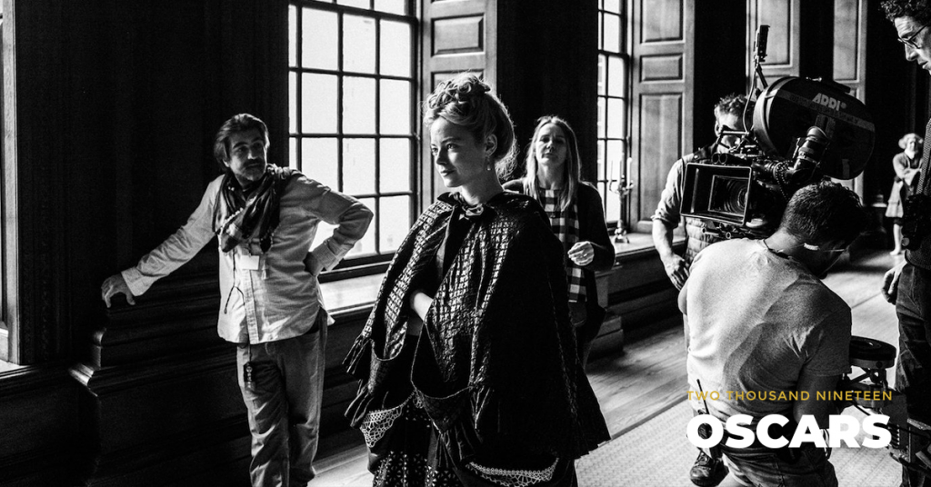 Emma Stone on the set of THE FAVOURITE. Photo by Yorgos Lanthimos.© 2018 Twentieth Century Fox Film Corporation All Rights Reserved