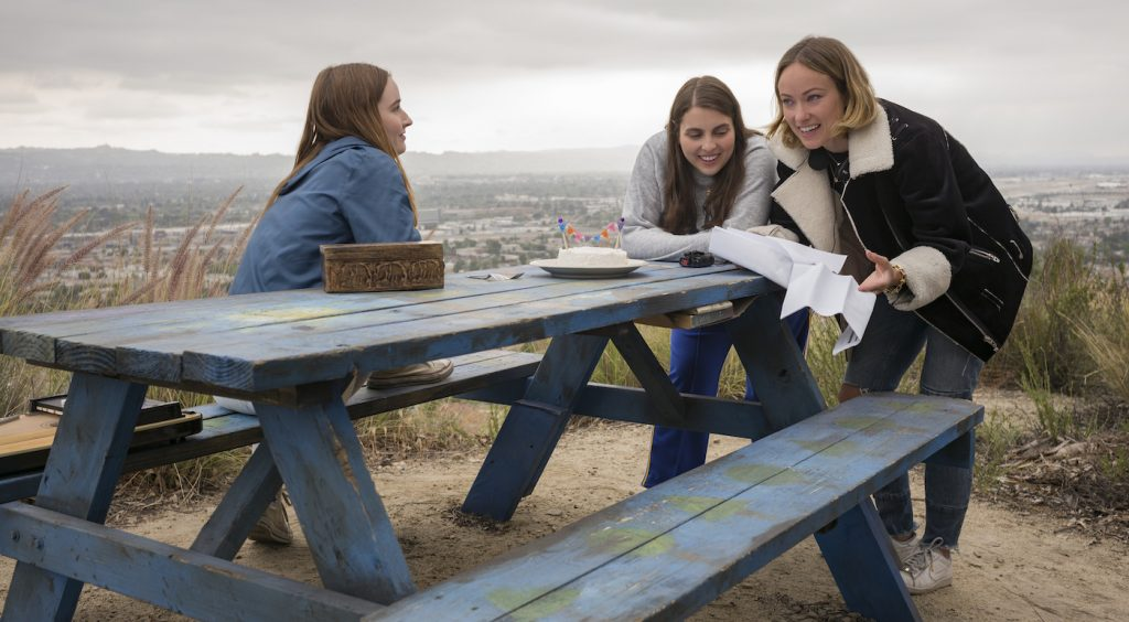Actors Kaitlyn Dever and Beanie Feldstein with director Olivia Wilde on the set of her directorial debut, BOOKSMART, an Annapurna Pictures release. Credit: Francois Duhamel / Annapurna Pictures