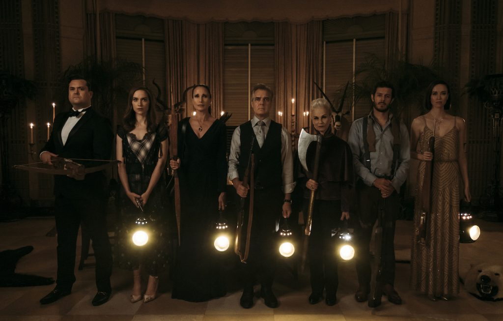 (L to R) Kristian Bruun, Melanie Scrofano, Andie MacDowell, Henry Czerny, Nicky Guadagni, Adam Brody, and Elyse Levesque in the film READY OR NOT. Photo by Eric Zachanowich. © 2019 Twentieth Century Fox Film Corporation All Rights Reserved