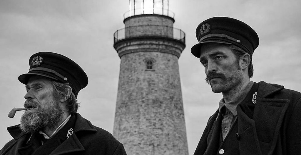 L-r: Willem Dafoe and Robert Pattinson in 'The Lighthouse.' Courtesy A24.