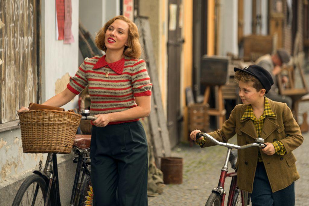 Scarlett Johansson and Roman Griffin Davis in the film JOJO RABBIT. Photo by Larry Horricks. © 2019 Twentieth Century Fox Film Corporation All Rights Reserved