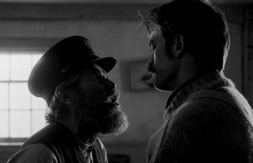 L-r: Willem Dafoe and Robert Pattinson in 'The Lighthouse.' Courtesy A24