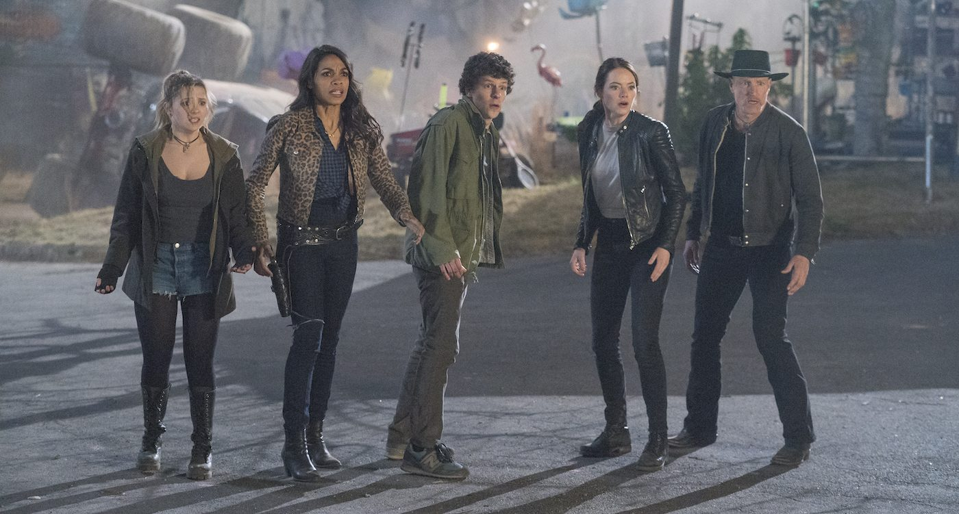 Woody Harrelson (Tallahassee)  Jesse Eisenberg (Columbus)  Emma Stone (Wichita)  Abigail Breslin (Little Rock)  Rosario Dawson (Nevada) in Columbia Pictures' ZOMBIELAND 2: DOUBLE TAP. Courtesy Sony Pictures.