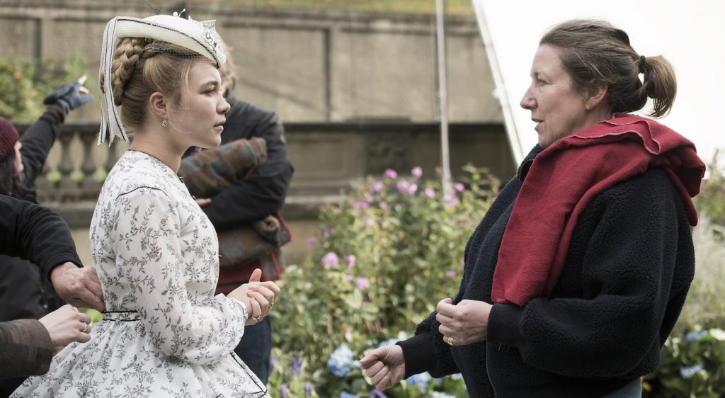 """BTS: Amy March (Florence Pugh), Costume Designer Jacqueline Durran on the set of Columbia Pictures' LITTLE WOMEN."""" Photo by Wilson Webb. Courtesy Sony Pictures."""