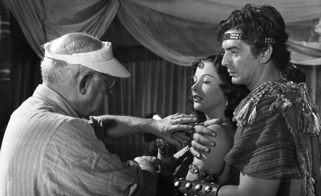 L-r: Director Cecille B. DeMille, Hedy Lamarr, and Victor Mature.