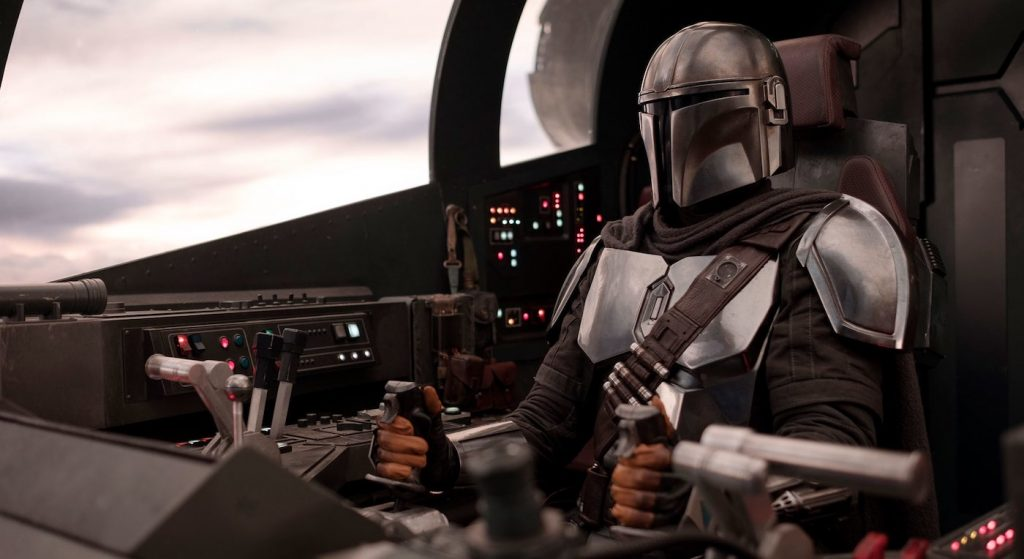 The Mandalorian (Pedro Pascal) in his ship the Falcon Crest. Courtesy Walt Disney Studios