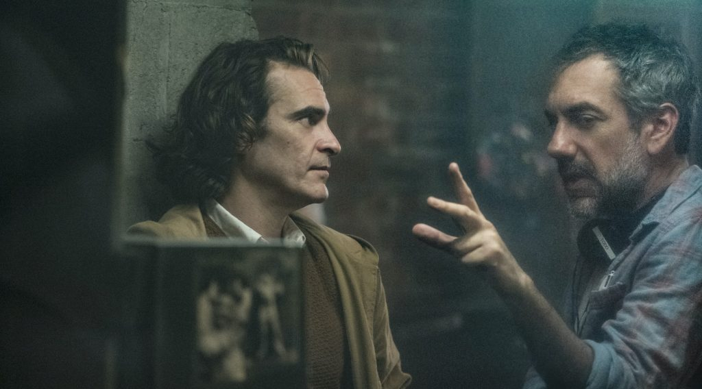L-r: Joaquin Phoenix and director Todd Phillips on the set of 'Joker.' Photo Credit: Niko Tavernise/Warner Bros.