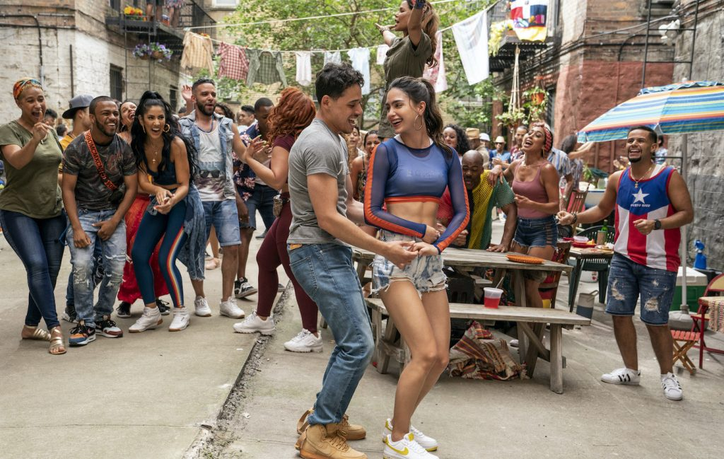 """Caption: (Left Center-Right Center) ANTHONY RAMOS as Usnavi and MELISSA BARRERA as Vanessa in Warner Bros. Pictures' """"IN THE HEIGHTS,"""" a Warner Bros. Pictures release. Photo Credit: Macall Polay"""