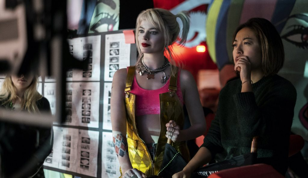 "Caption: (L-r) MARGOT ROBBIE and director CATHY YAN on the set of Warner Bros. Pictures' ""BIRDS OF PREY (AND THE FANTABULOUS EMANCIPATION OF ONE HARLEY QUINN),"" a Warner Bros. Pictures release."