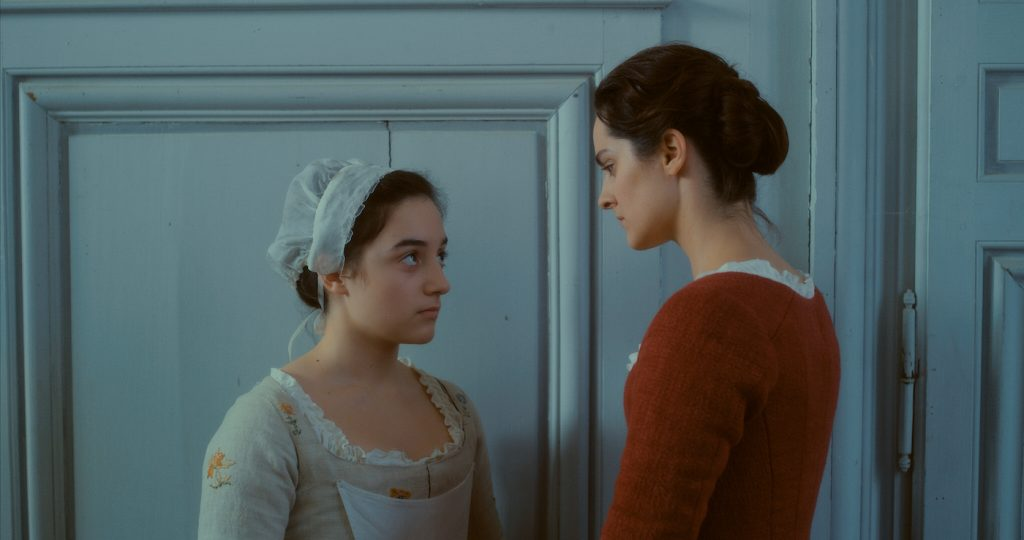 L-r: Luàna Bajrami is Sophie and Noémi Merlant is Marianne in 'Portrait of a Lady on Fire.' Courtesy Neon.