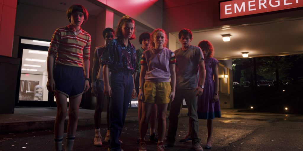 L-r: Noah Schnapp, Caleb McLaughlin, Millie Bobby Brown, Finn Wolfhard, Sadie Sink, Charlie Heaton, Natalia Dyer in 'Stranger Things' season 3. Courtesy Netflix.