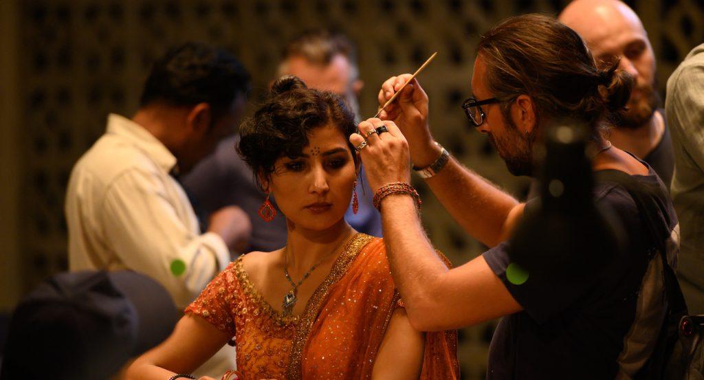 Luca Vanella doing the hair for Golshifteh Farahani. Courtesy of Netflix.
