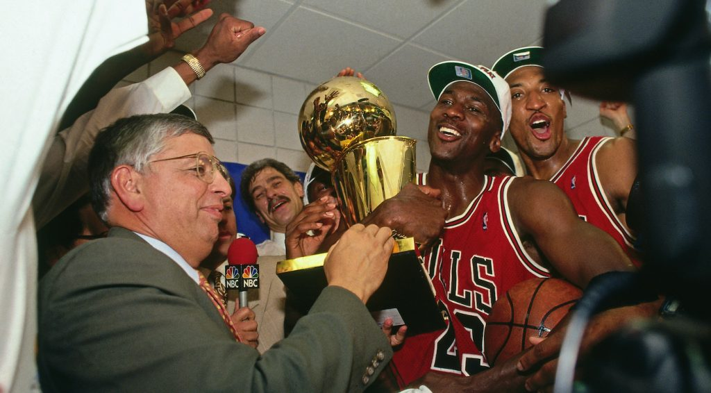 PHOENIX - JUNE 20: NBA Commissioner David Stern presents Michael Jordan and the Chicago Bulls the championship trophy after the Bulls defeated the Phoenix Suns in Game Six of the 1993 NBA Finals on June 20, 1993 at America West Arena in Phoenix, Arizona. (Photo by Andrew D. Bernstein/NBAE via Getty Images)