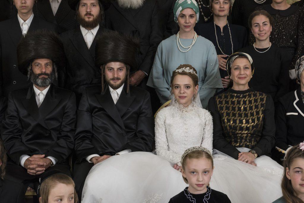 L-r: Amit Rahav is Yanky Shapiro and Shira Haas is Esher Shapiro. Photo by Anika Molnar/Netflix