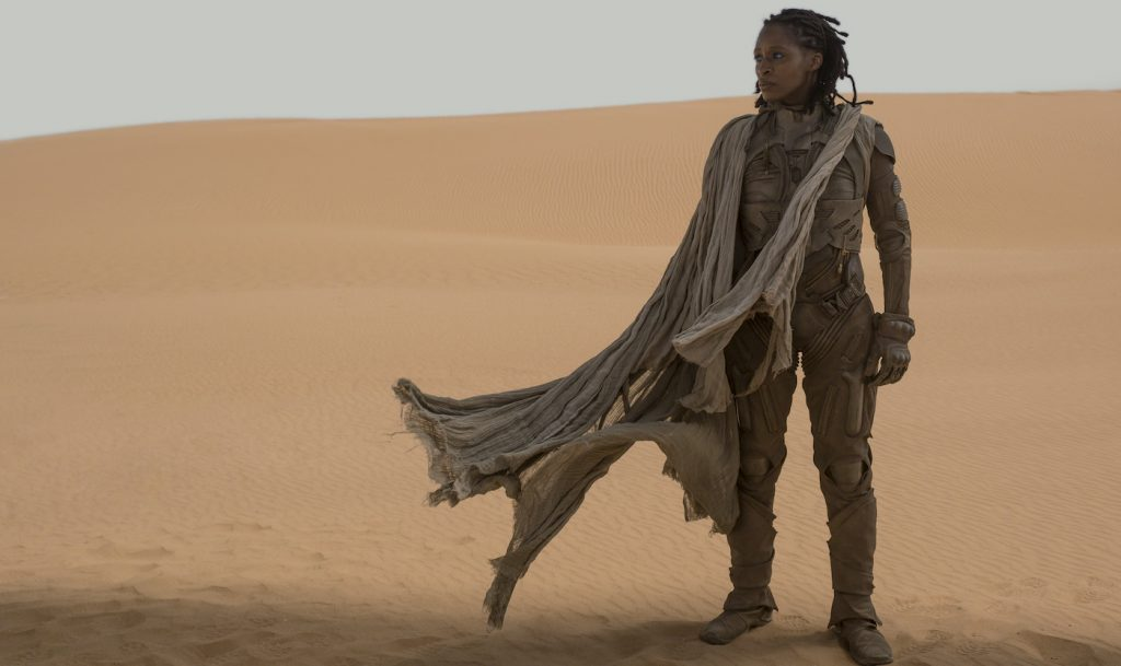 "Caption: SHARON DUNCAN-BREWSTER as Liet Kynes in Warner Bros. Pictures and Legendary Pictures' action adventure ""DUNE,"" a Warner Bros. Pictures release. Photo Credit: Chiabella James"