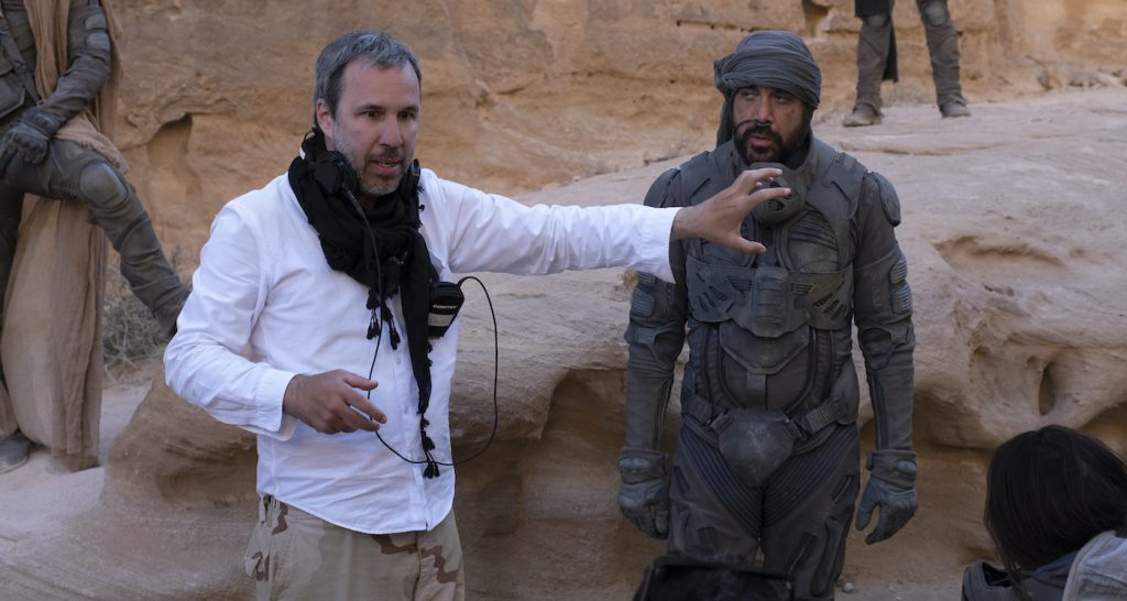 "Caption: (L-r) Director DENIS VILLENEUVE and JAVIER BARDEM on the set of Warner Bros. Pictures and Legendary Pictures' action adventure ""DUNE,"" a Warner Bros. Pictures release. Photo Credit: Chiabella James"