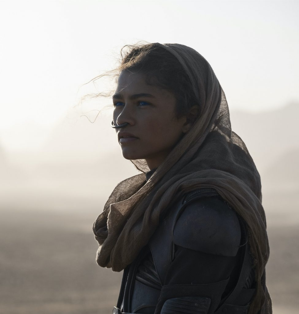 "Caption: ZENDAYA as Chani in Warner Bros. Pictures and Legendary Pictures' action adventure ""DUNE,"" a Warner Bros. Pictures release. Photo Credit: Chiabella James"