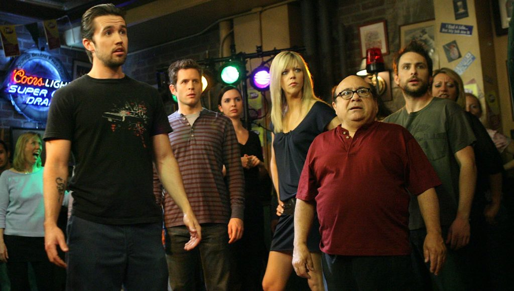 LOS ANGELES, CA - MAY 23:  (L-R) Actors Rob McElhenney, Glenn Howerton, Kaitlin Olson, Danny DeVito and Charlie Day act during a dance scene on the set of