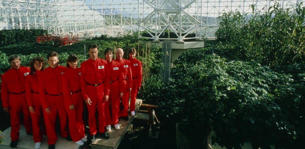 The 'Biospherians' pose for the camera during the final construction phase of the Biosphere 2 project in 1990. Left to right are: Mark Nelson, Linda Leigh, Taber MacCallum, Abigail Alling, Mark Van Thillo, Sally Silverstone, Roy Walford and Jayne Poynter. The 3.1 acre air- and water-tight building became their home for two years. Biosphere 2 was designed to allow study of human survival in a sealed ecosystem. The costs of this controversial, $150 million project were met from private funds. The Biosphere 2 project building is at Oracle, Arizona.
