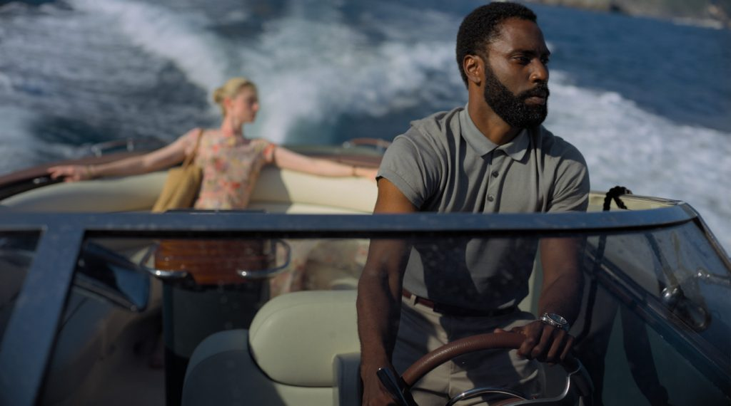 Caption: (L-r) ELIZABETH DEBICKI and JOHN DAVID WASHINGTON in Warner Bros. Pictures' action epic