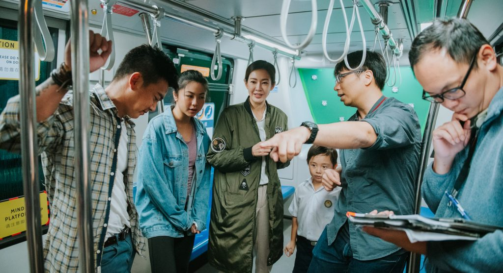 JD Chau (at right, pointing) on the set of 'Circle Line.' Courtesy Joan Foo.