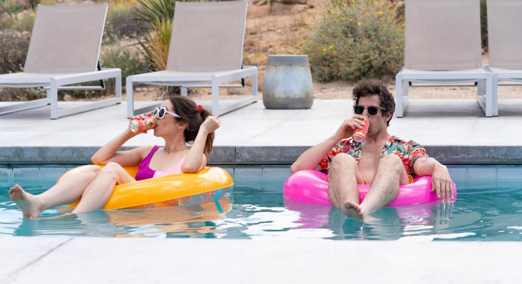 Palm Springs -- When carefree Nyles (Andy Samberg) and reluctant maid of honor Sarah (Cristin Milioti) have a chance encounter at a Palm Springs wedding, things get complicated when they find themselves unable to escape the venue, themselves, or each other. Sarah (Cristin Milioti) and Nyles (Andy Samberg), shown. (Photo by: Jessica Perez/Hulu)